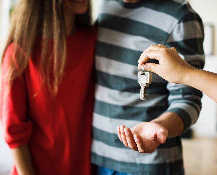 Couple getting keys to their new home